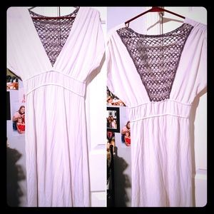 Loose fitting deep V-neck w/a beautiful back